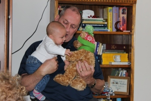 My dad giving Olivia her very first Christmas present.