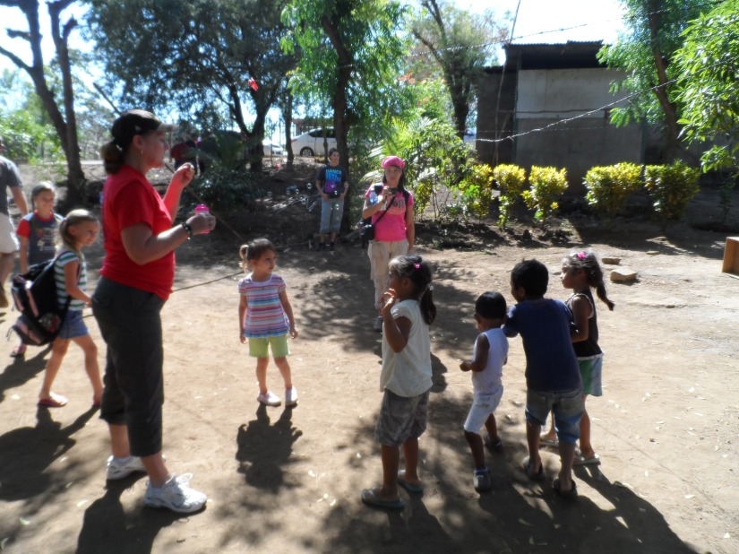 Blowing bubbles with Debbie and the Nica kids.