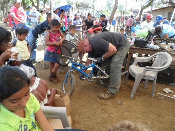 Steve McPhereson working on a bicycle.