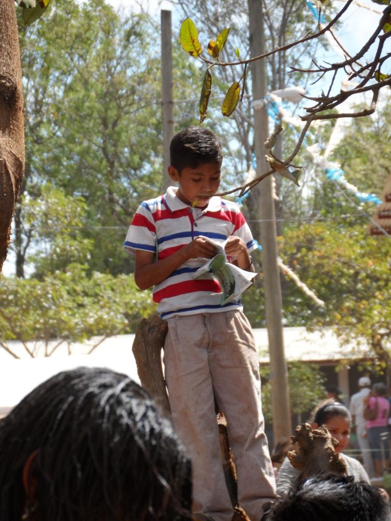A young boy reading through his new Gospel of John.