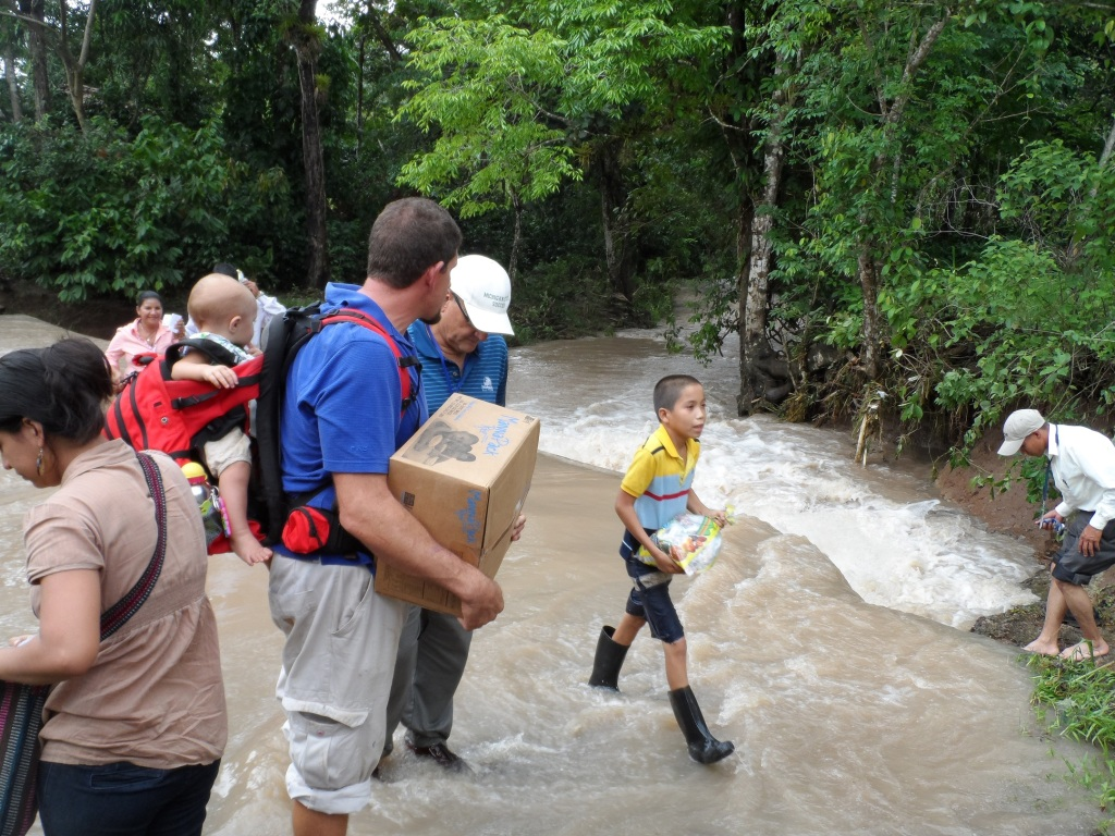 Crossing a river by foot in La Dalia to share the Gospel!