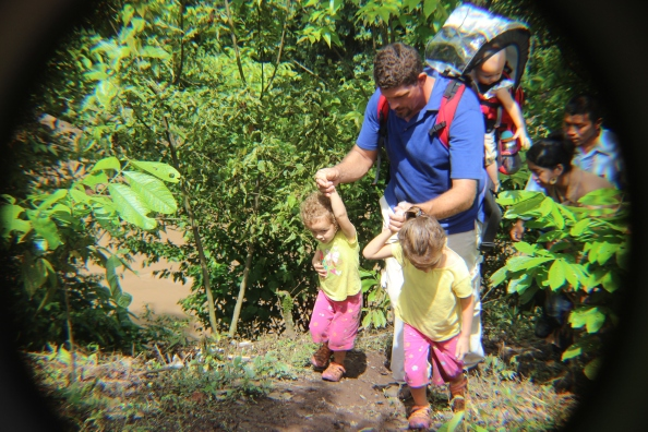 Phillip helping Emma & Paige walk in the mountains of Nicaragua.