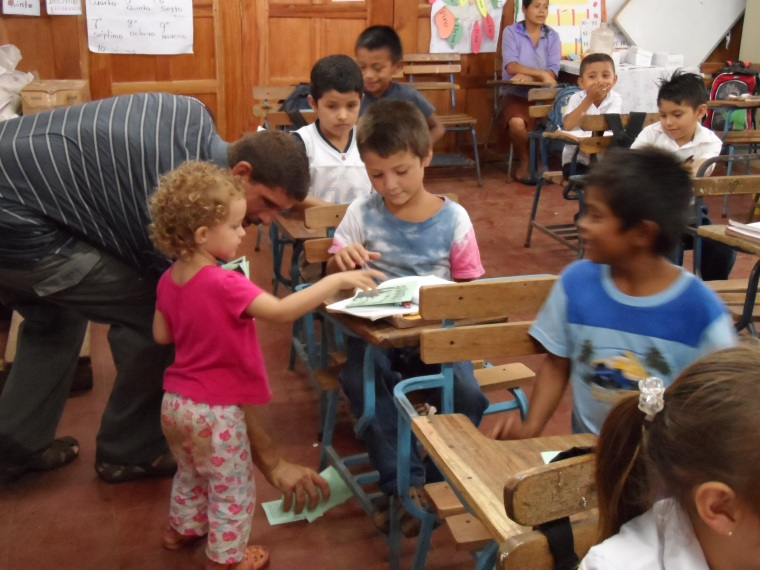 Paige handing out Gospels of John in a classroom in Nicaragua.