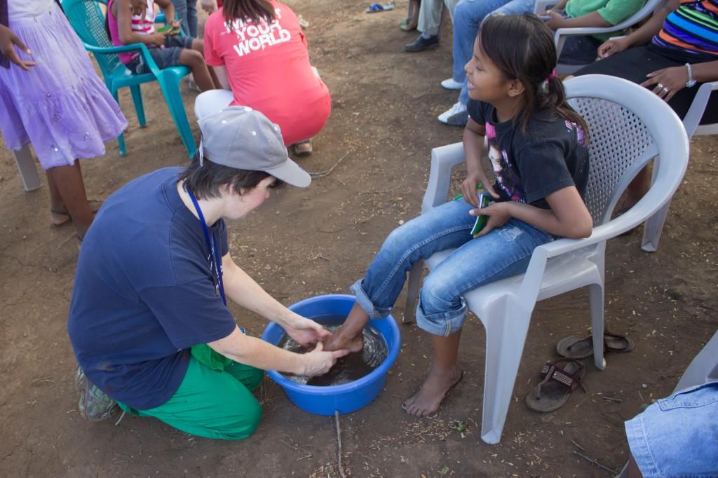 Washing feet in the childrens' discipleship program.
