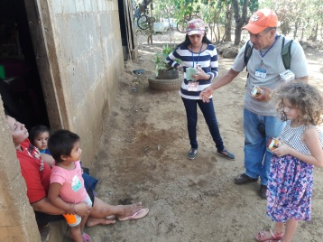 Paige sharing the EvangeCube with our translator Marcos and one of our students, Ashley.