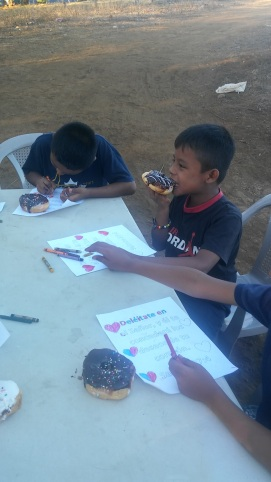 We bring a special treat for the kids every Saturday, but this time was extra special...donuts!